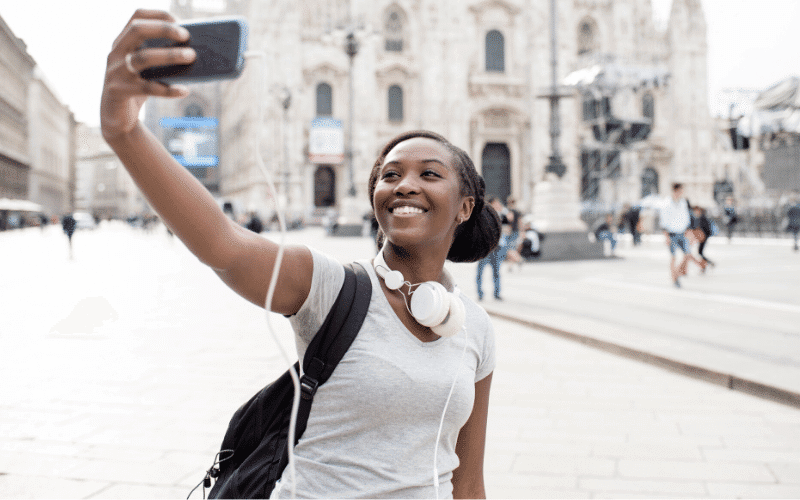 woman taking a photo for social media