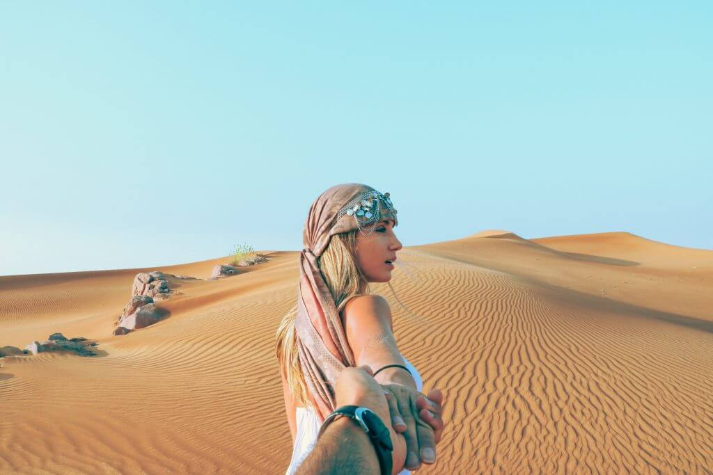 man and woman in a desert